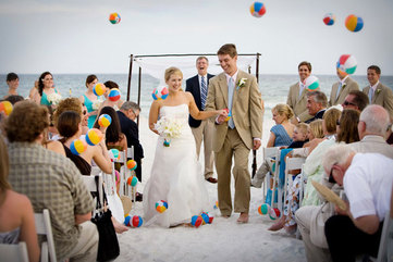 send off the bride and groom with mini beach balls at a beach themed wedding #PreppyPlanner